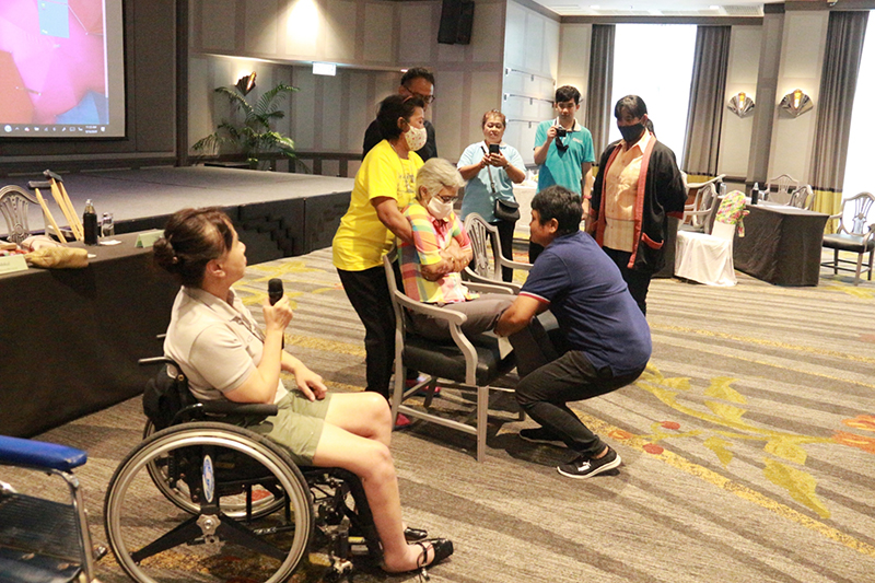 Ms. Nongnuch Maytarjittipun, Executive Secretary to the Executive Director, shared first-hand knowledge on how to carry persons with physical disabilities via role play